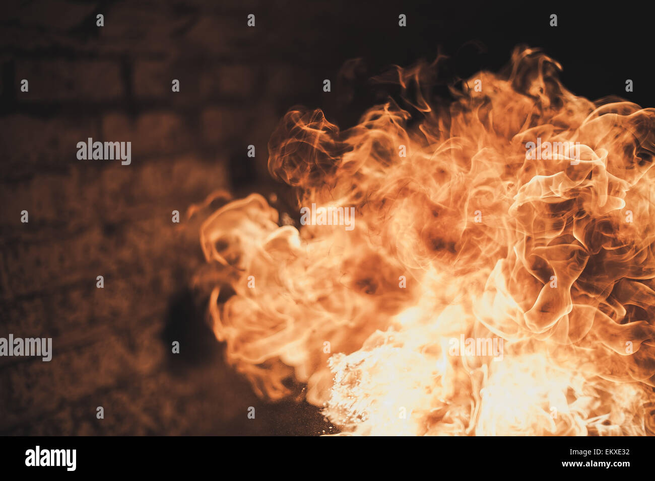 a fire ball backed by a brick background - Stock Image