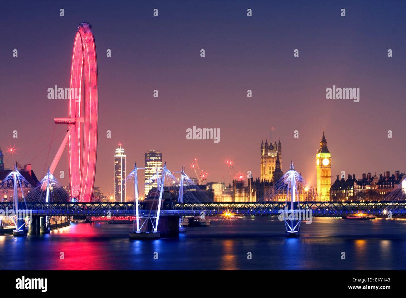 London at night. London Eye Hungerford Bridge and Golden Jubilee Bridges and Palace of Westminster with illuminated Stock Photo