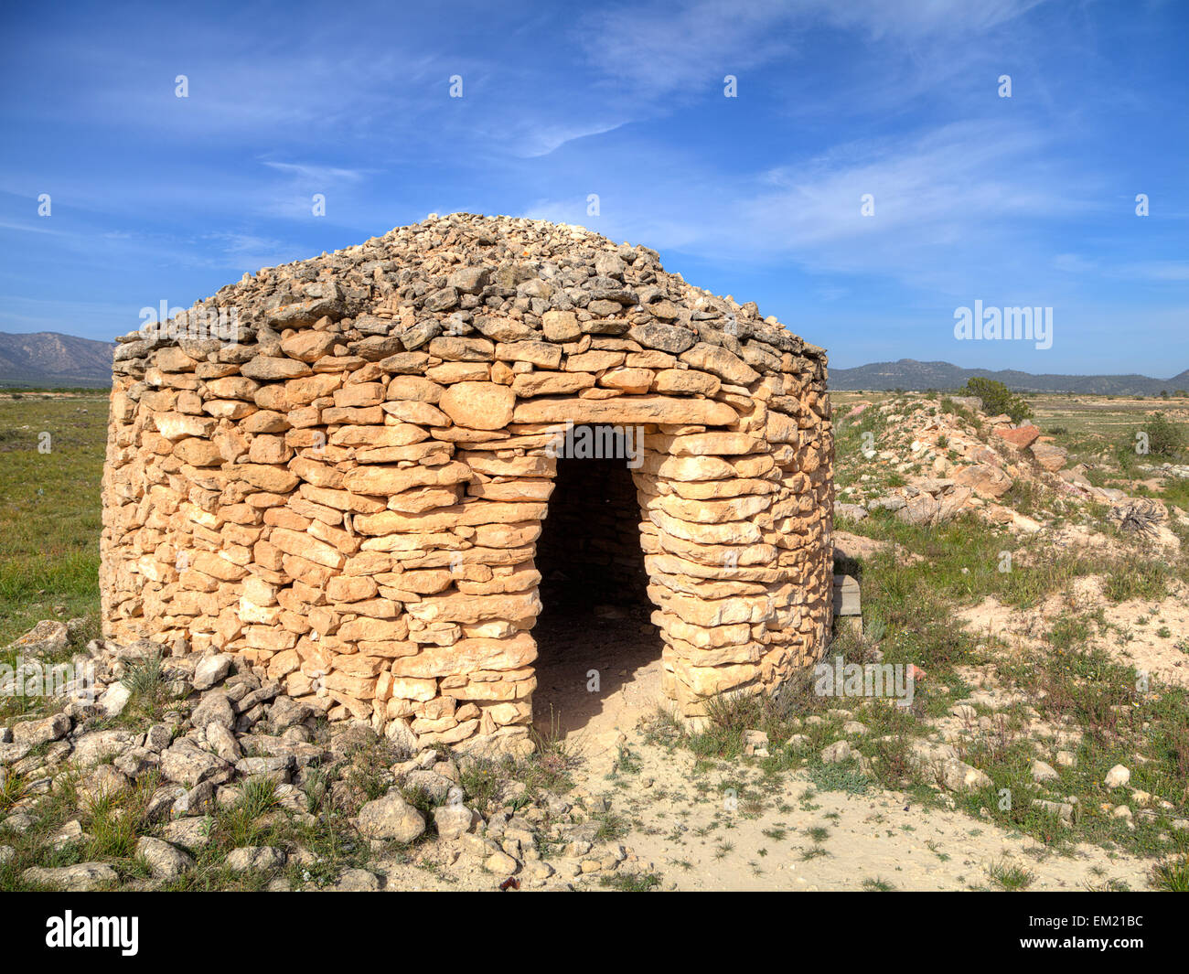 Stone built shepherd's hut in the Alicante region of Spain, used as shelter when moving goats and sheep between Stock Photo