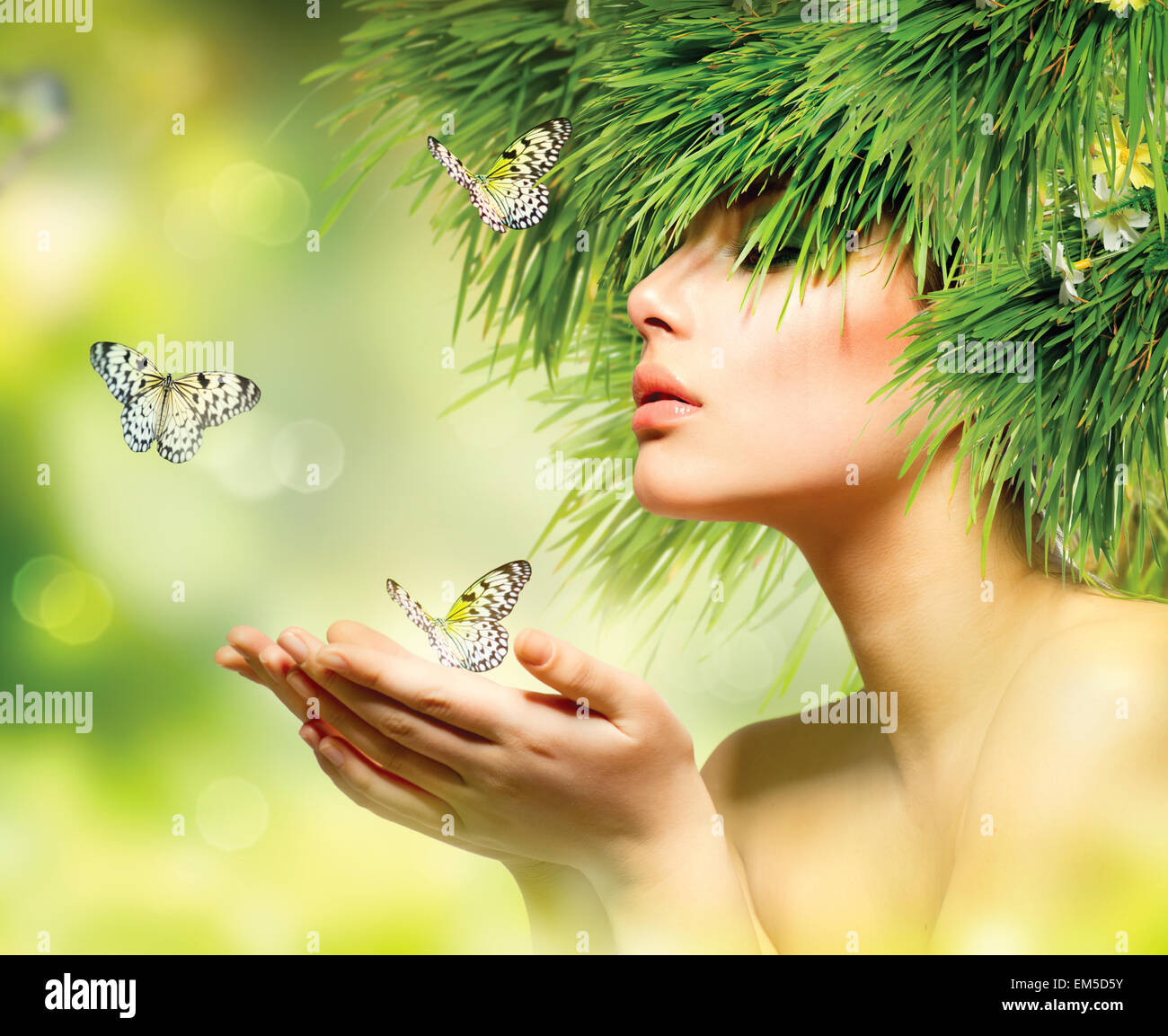 Spring Woman. Summer Girl with Grass Hair and Green Makeup - Stock Image