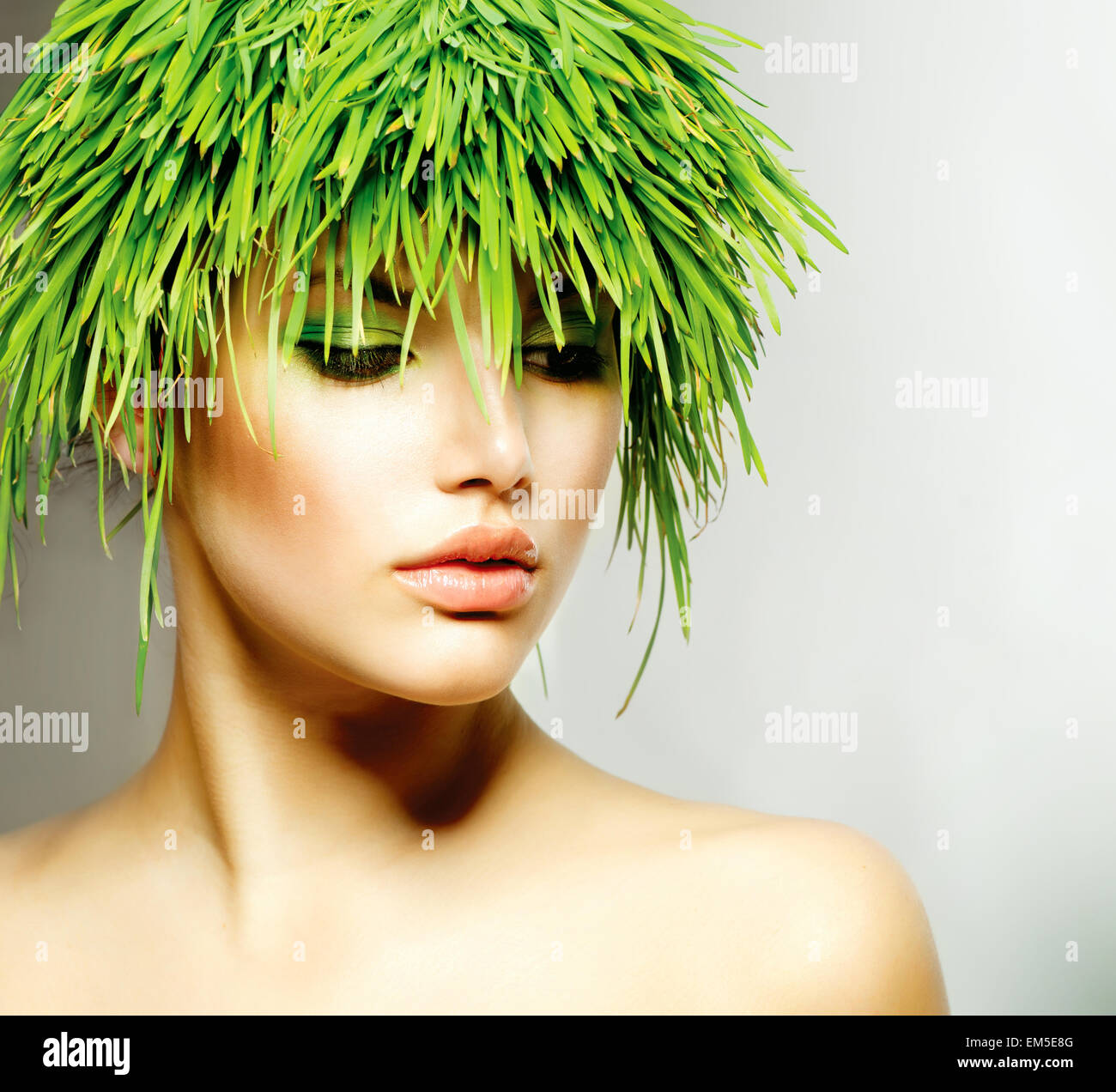 Beauty Spring Woman with Fresh Green Grass Hair - Stock Image