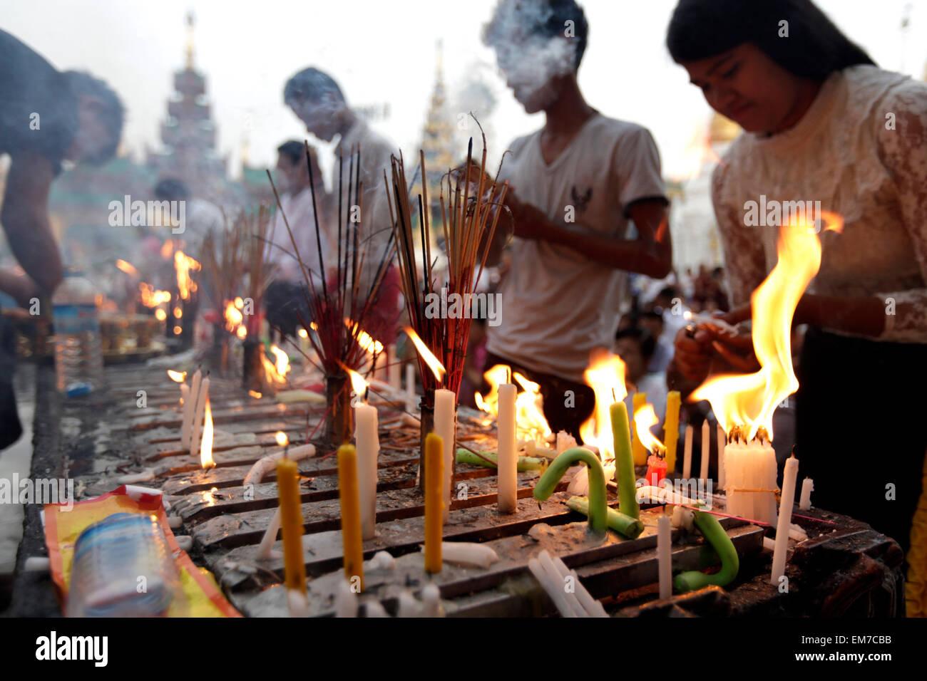 Yangon, Myanmar  17th Apr, 2015  People light candles and burn Stock