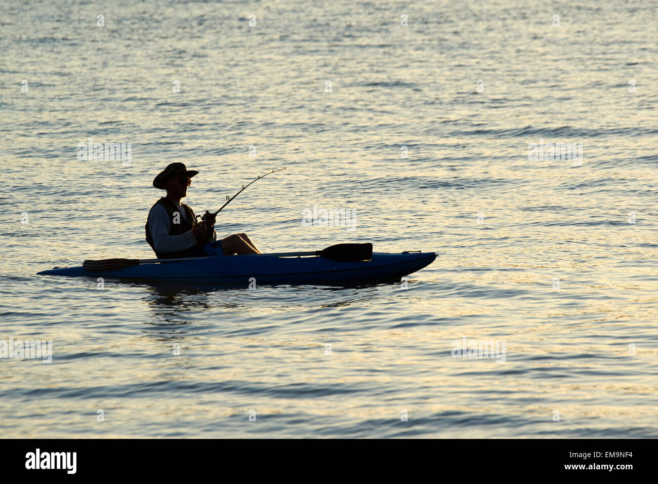 Angling off a canoe - Stock Image