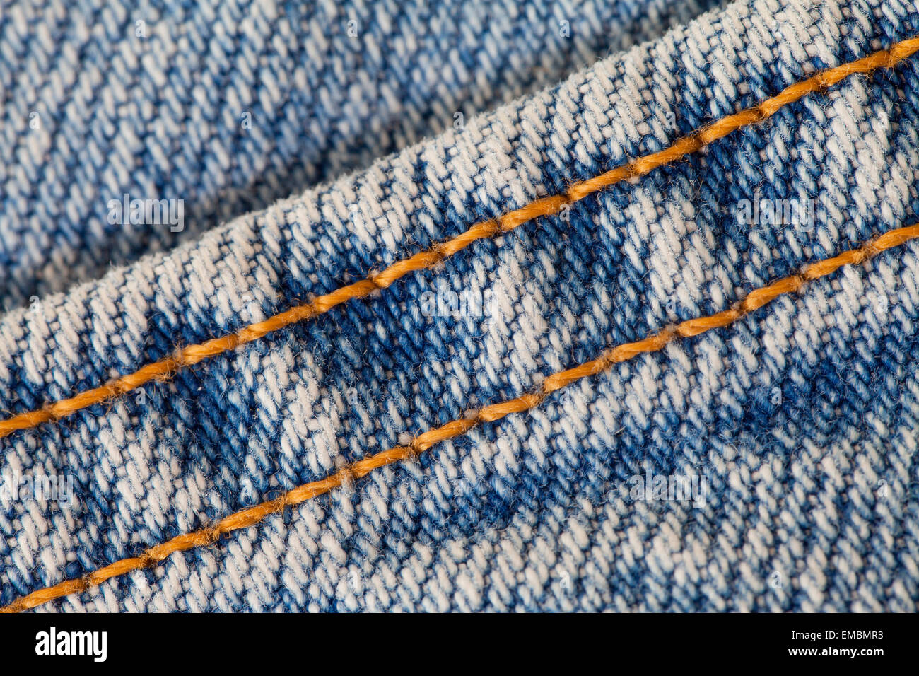 Seam on blue jean denim fabric - Stock Image