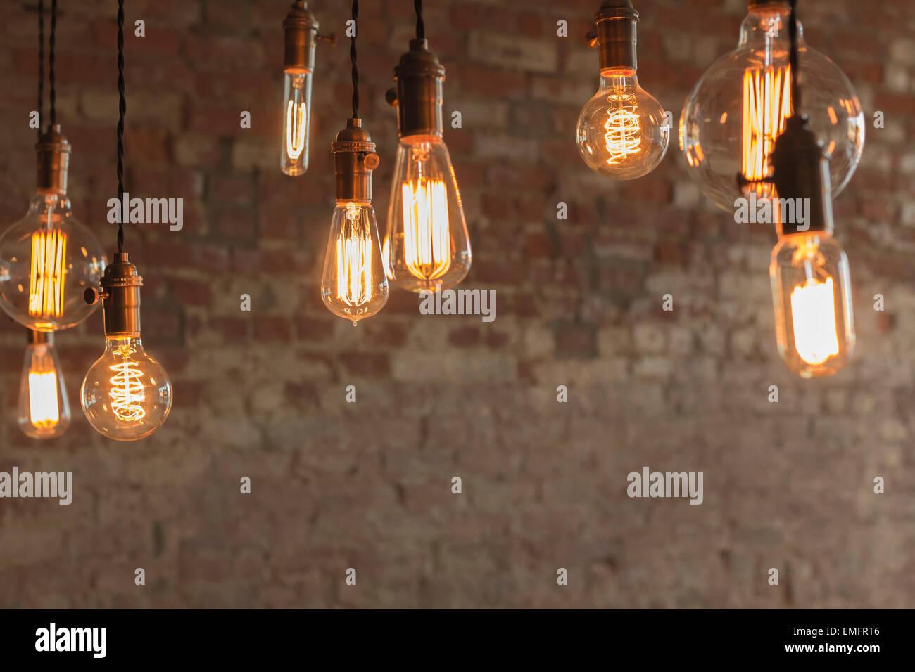 Decorative antique edison style light bulbs against brick wall stock decorative antique edison style light bulbs against brick wall background aloadofball Images