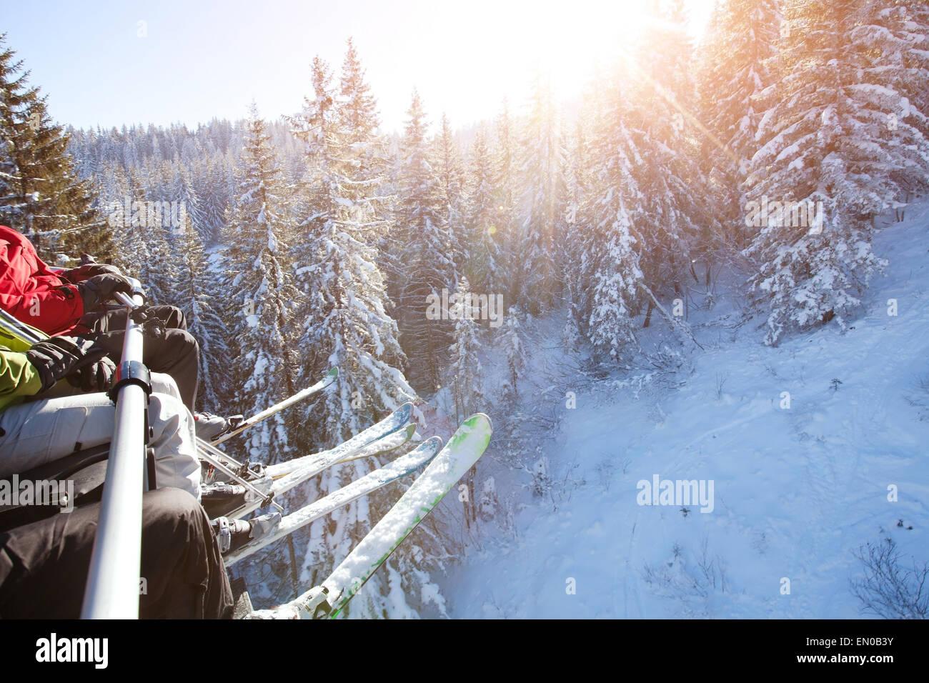 family sitting in ski lift - Stock Image