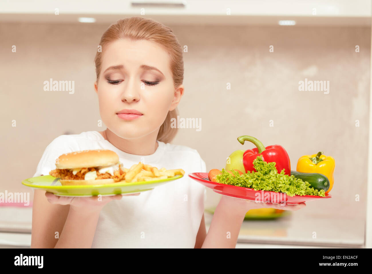 Young woman choosing lunchStock Photo