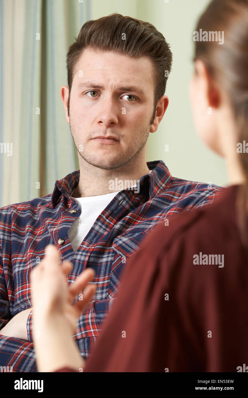 Depressed Young Man Talking To Counsellor - Stock Image