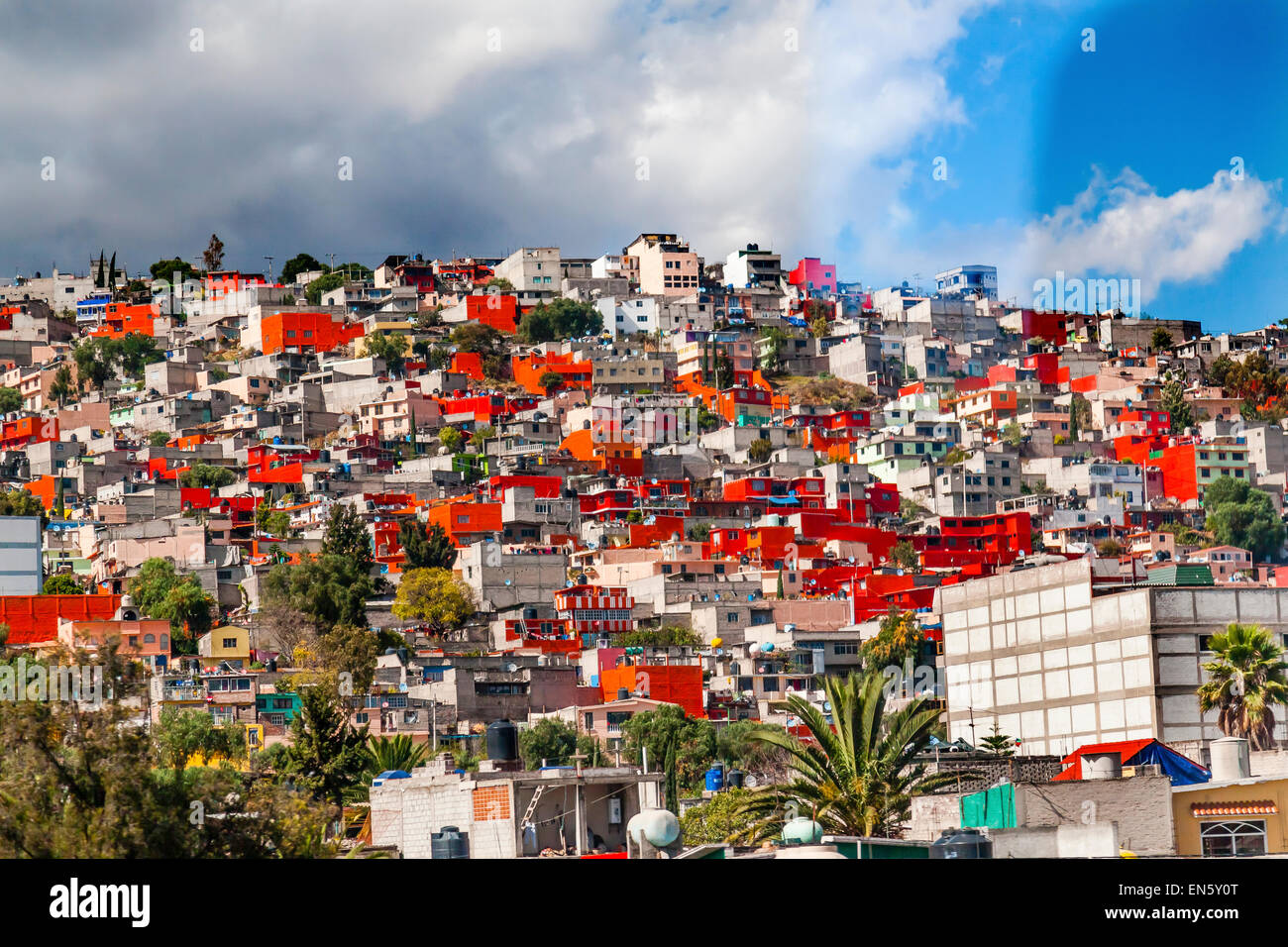 Colorful Orange Houses Suburbs, Outskirts Outside Rainstorm Mexico City Mexico  Colorful Orange Houses makes pattern. - Stock Image