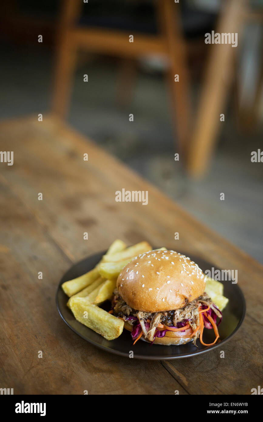 pulled pork bun with thick fries - Stock Image