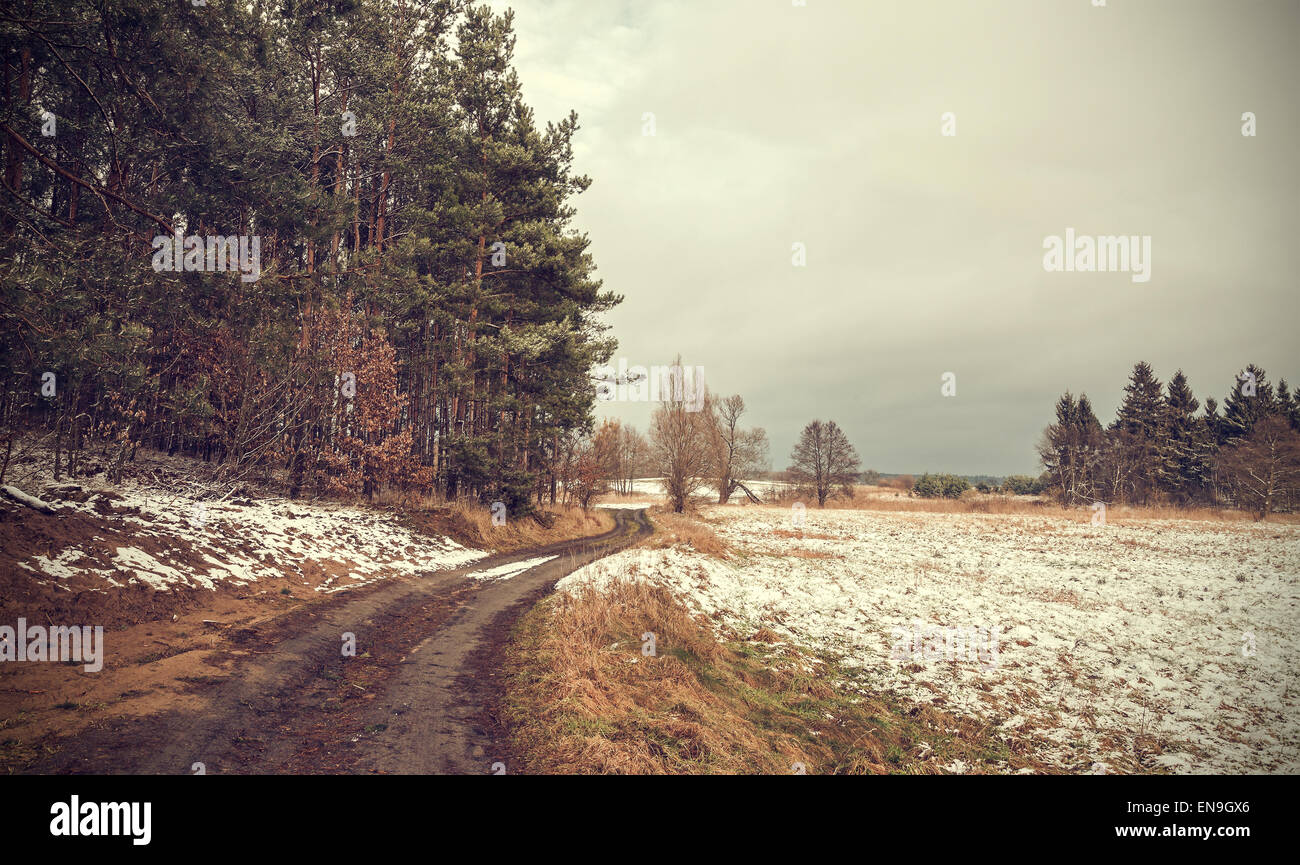 Retro toned peaceful rural landscape with vignette effect. - Stock Image