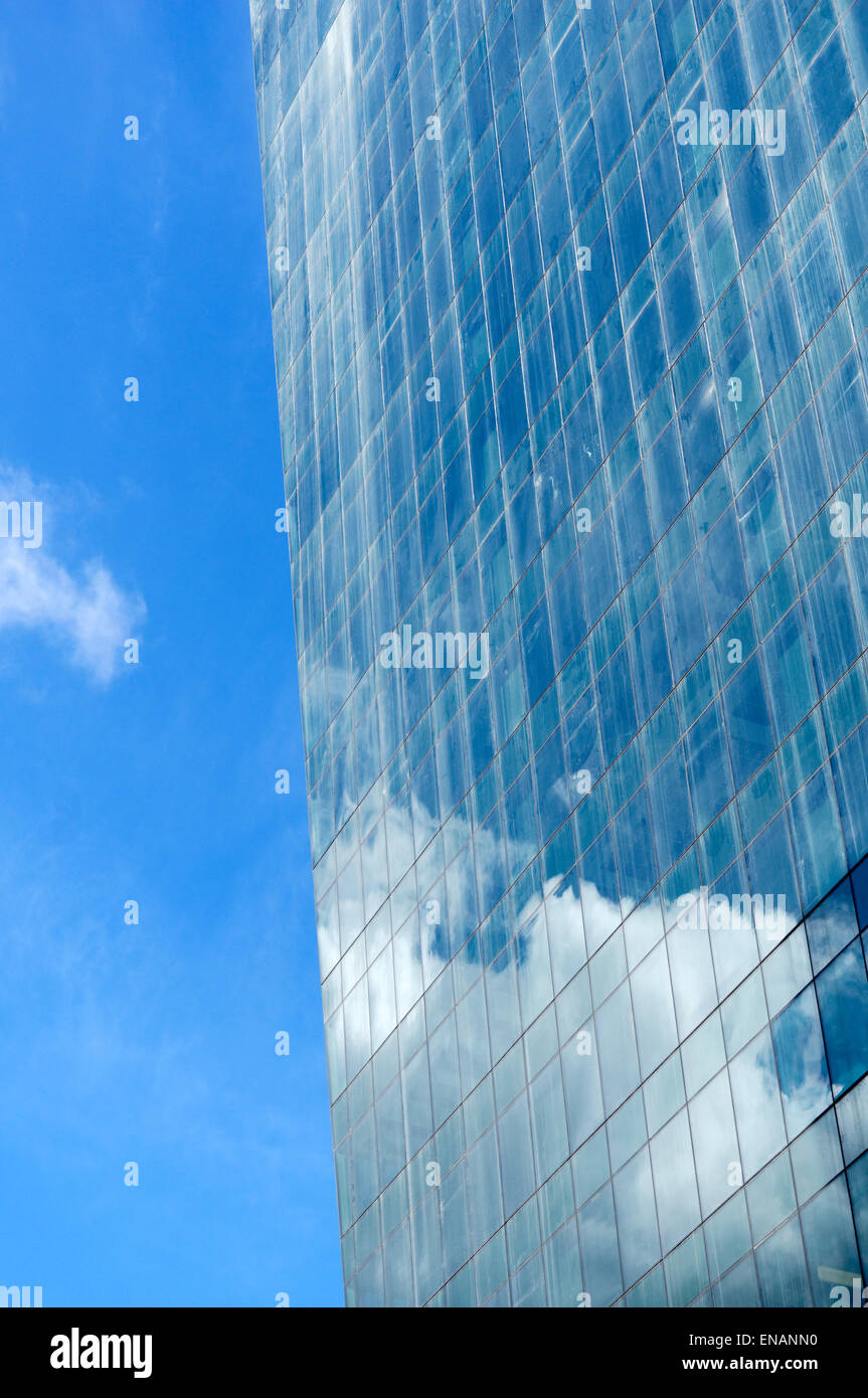 clouds-and-blue-sky-reflected-in-the-gla