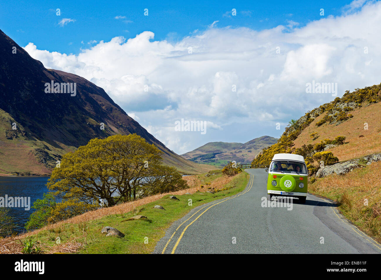 Classic VW campervan on road next to Crummockwater (B5289), Lake District National Park, Cumbria, England UK Stock Photo