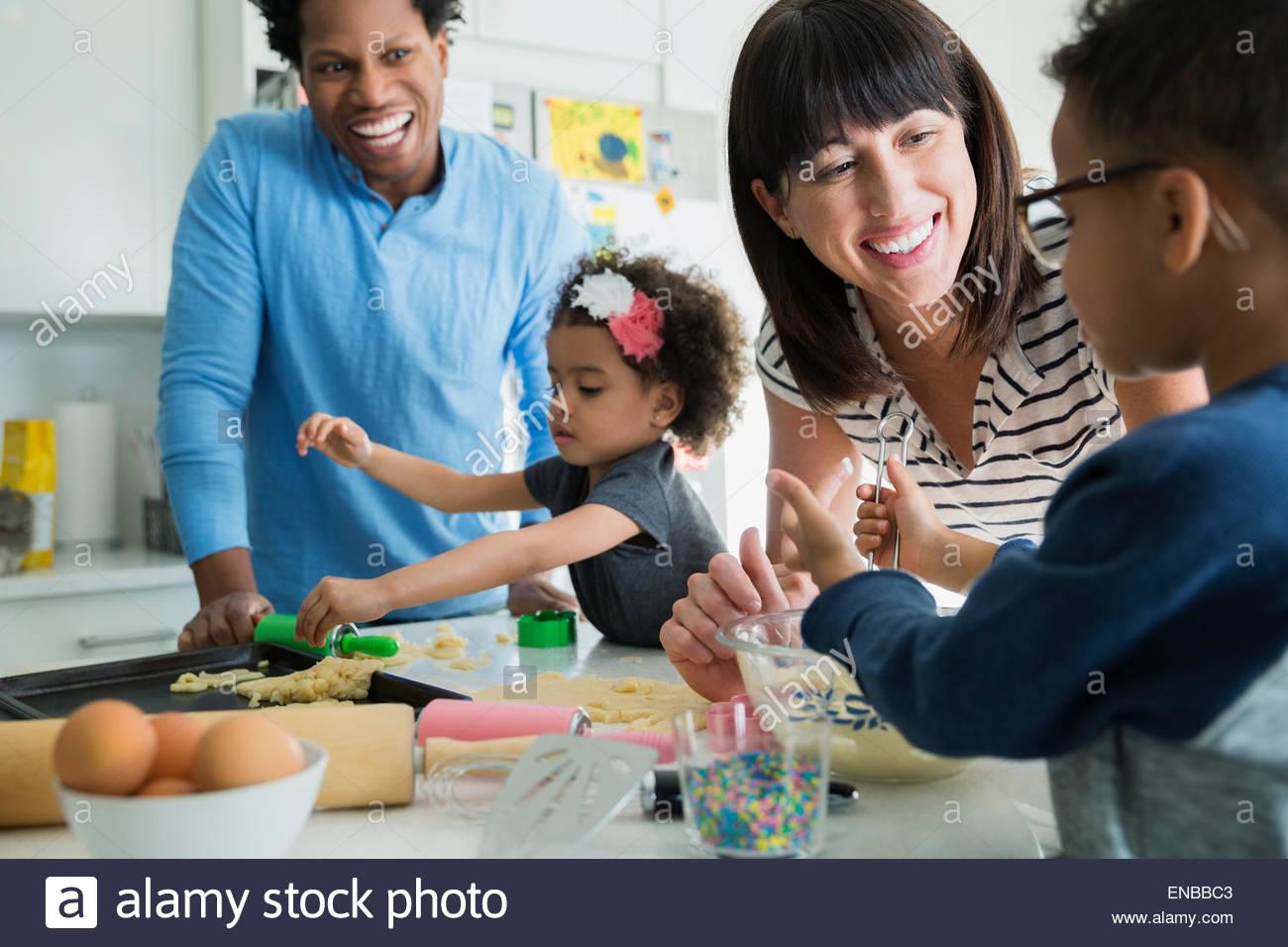 Family baking in kitchen - Stock Image