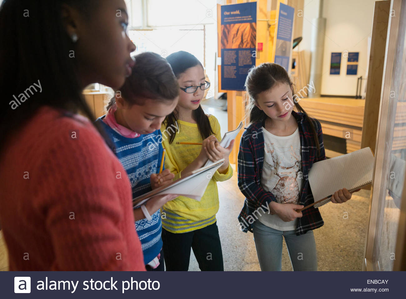 Students taking notes geology exhibit at science center - Stock Image
