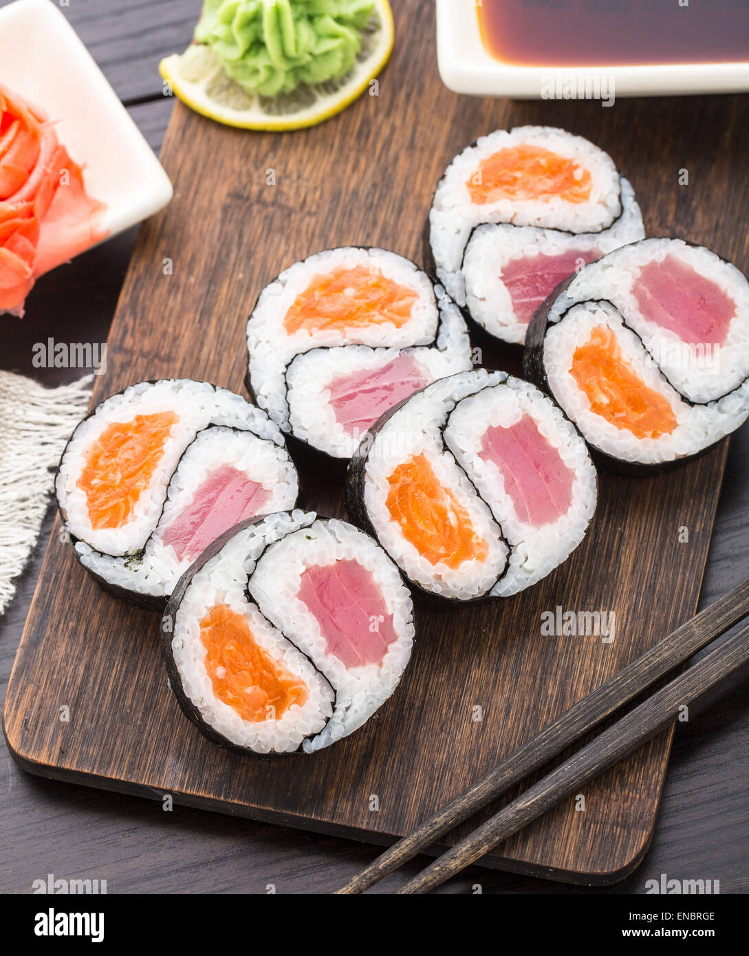 Yin yang futomaki with tuna and salmon on a wooden board - Stock Image