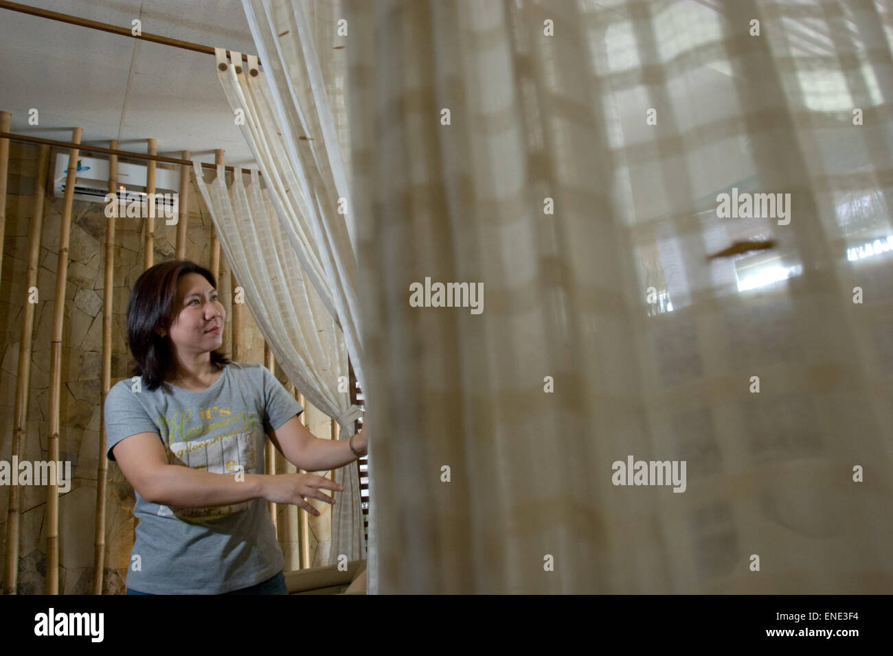 Susi Susanti, retired badminton player, opens her foot reflexology and sports physiotherapy center called Fontana - Stock Image