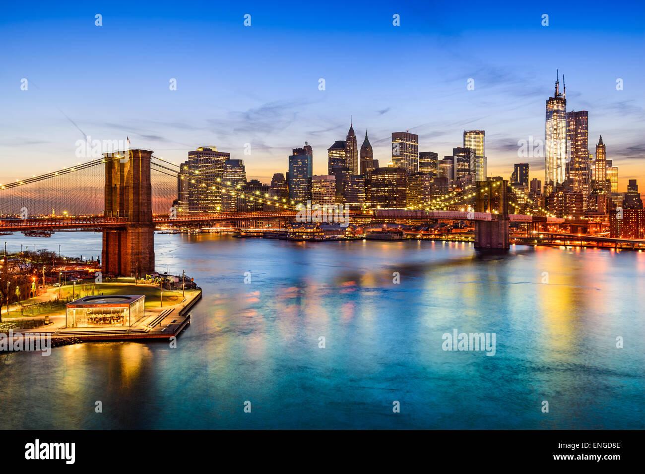 New York City, USA skyline over East River and Brooklyn Bridge. - Stock Image