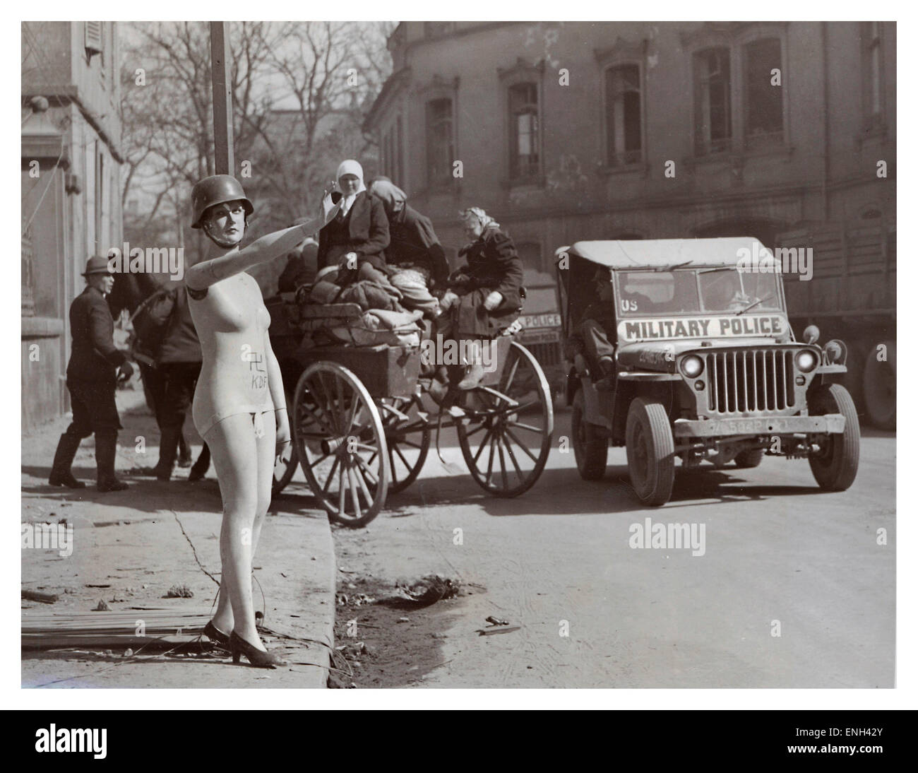 OCCUPIED BERLIN WW2 Dark humour image in post war 1945 Berlin of helmeted shop mannequin giving Hitler salute with - Stock Image