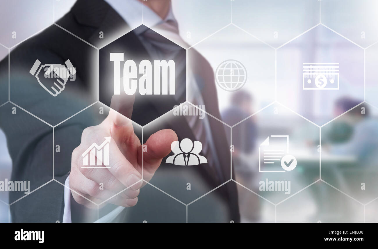 Businessman pressing an Team concept button. - Stock Image