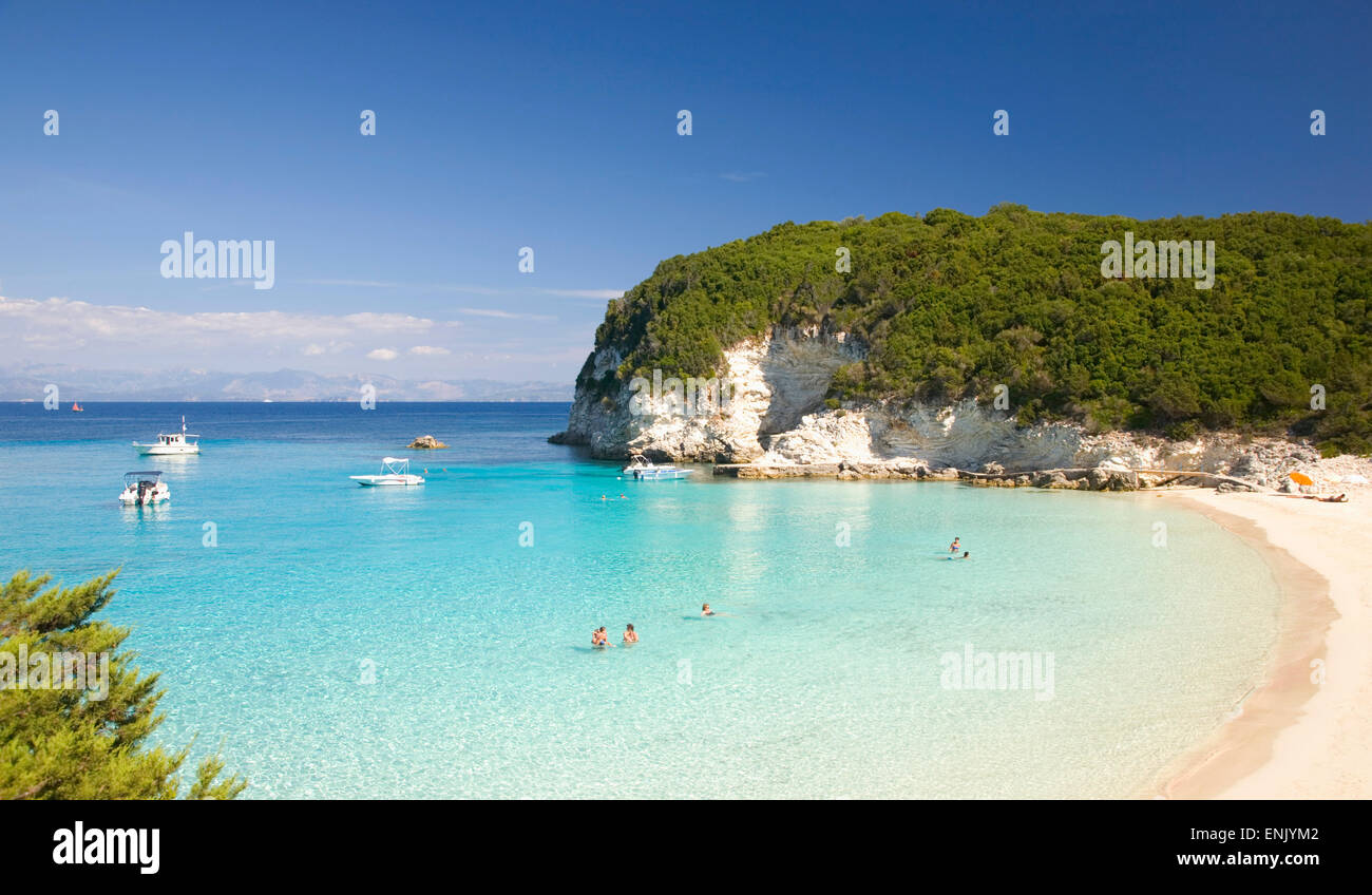 View across the clear turquoise waters of Vrika Bay, Antipaxos, Paxi, Corfu, Ionian Islands, Greek Islands, Greece, - Stock Image