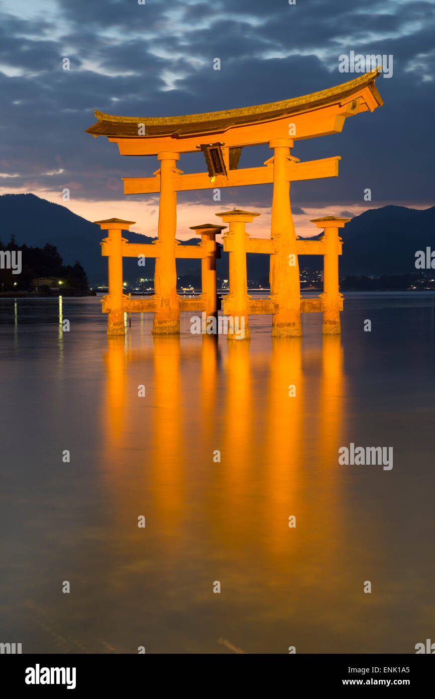 The floating Miyajima torii gate of Itsukushima Shrine at dusk, UNESCO, Miyajima Island, Western Honshu, Japan, - Stock Image