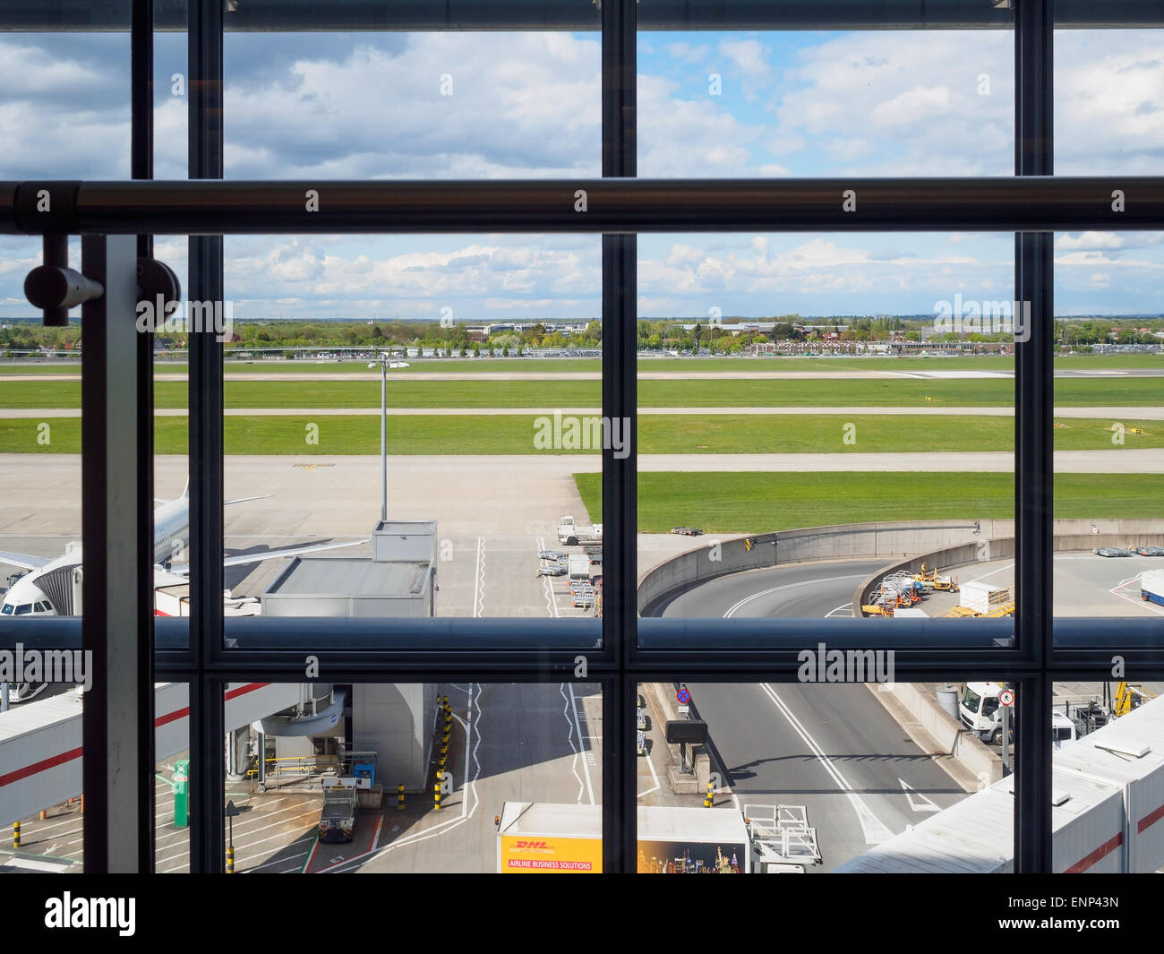 A view of the runway at Heathrow Airport from Terminal 5 lounge, London. - Stock Image