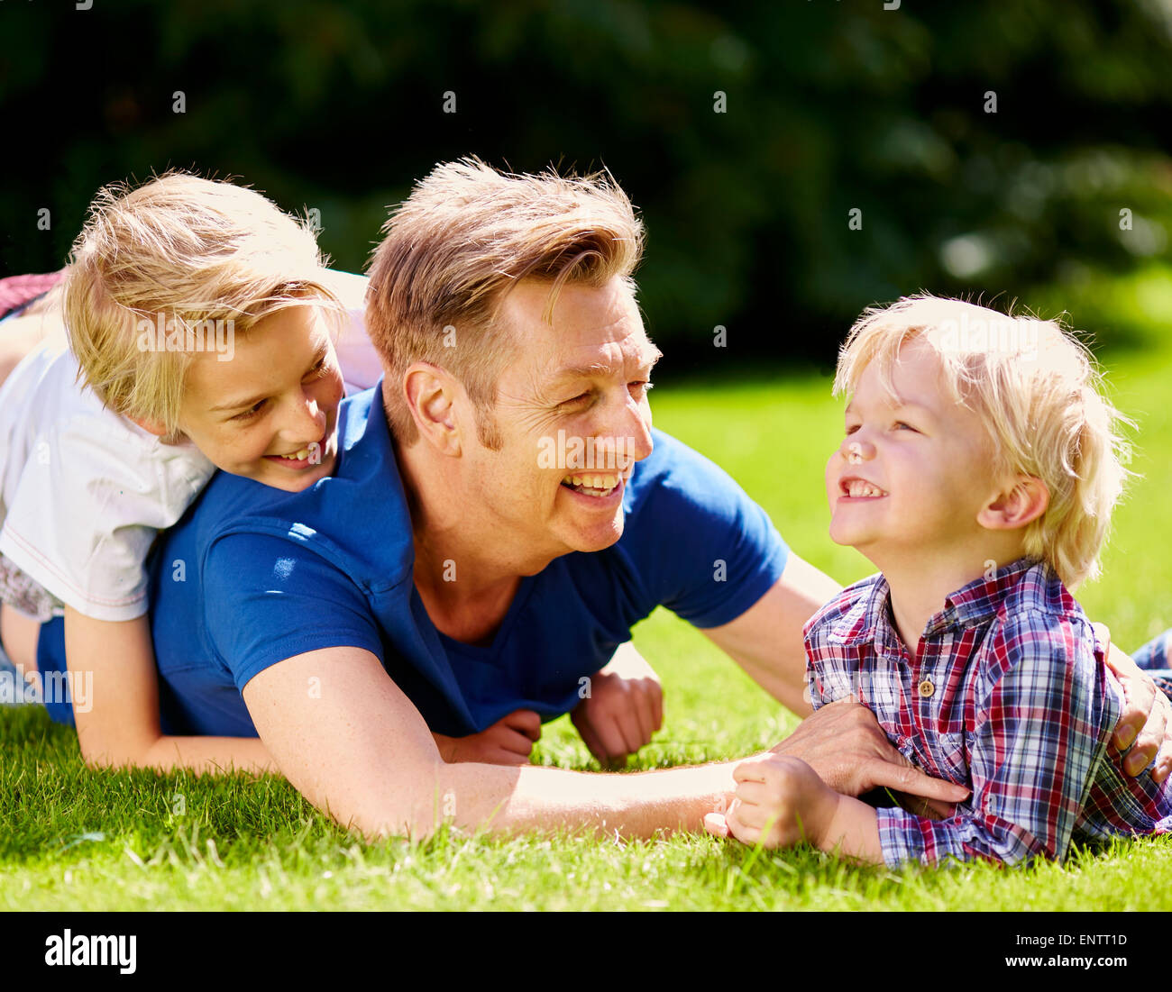 Father playing with is children outdoors - Stock Image