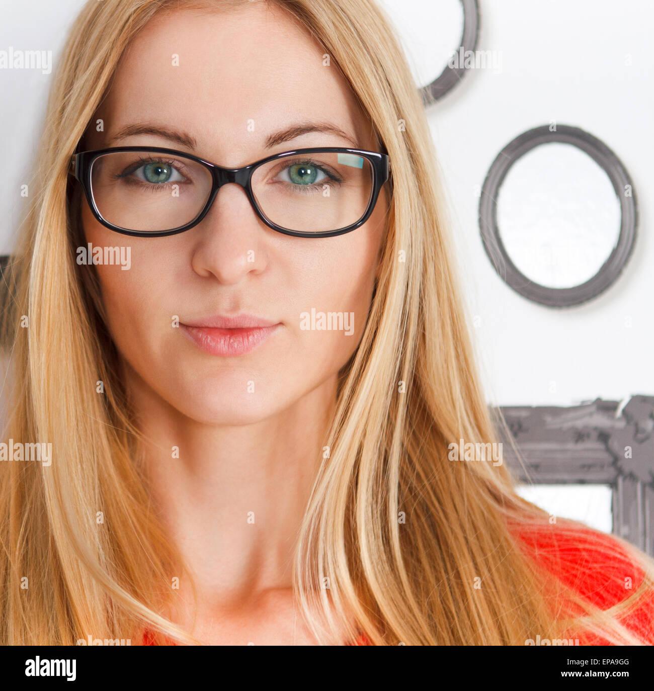 Portrait of the woman wearing black eye glasses - Stock Image