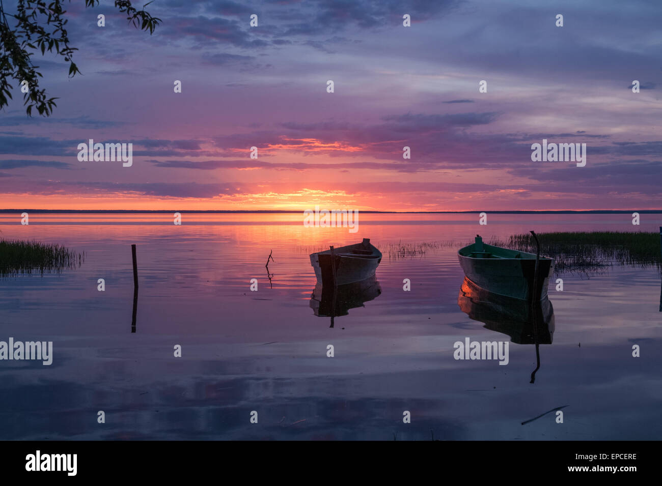 two boats on pier expect the owners from a decline till the dawn - Stock Image