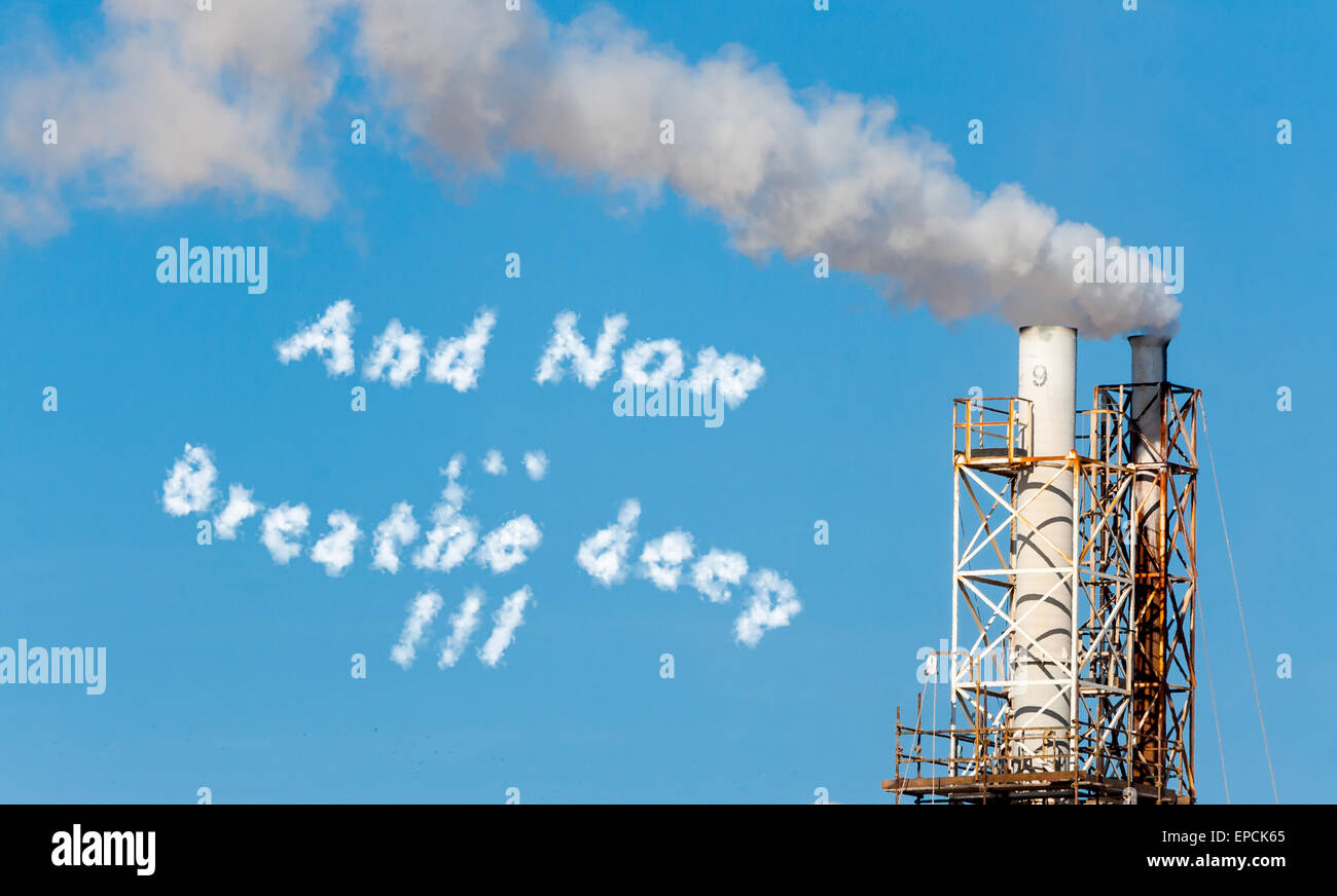 White smoke in the blue sky with written in cloud text. - Stock Image