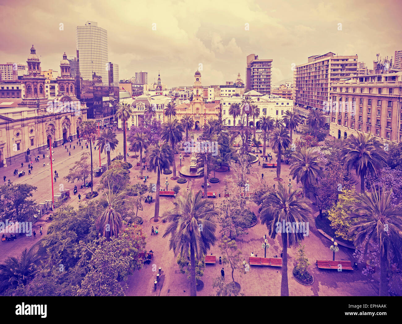 Vintage stylized photo of Santiago de Chile downtown, Plaza de Armas where modern skyscrapers mix with historic - Stock Image