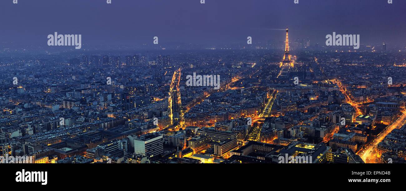 Aerial panoramic view of Paris at night from Tour Montparnasse - Stock Image