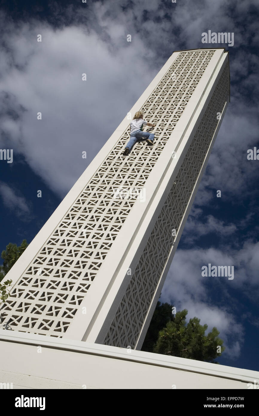 Michael Reardon scaling the side of a tall building in Salt Lake City. - Stock Image