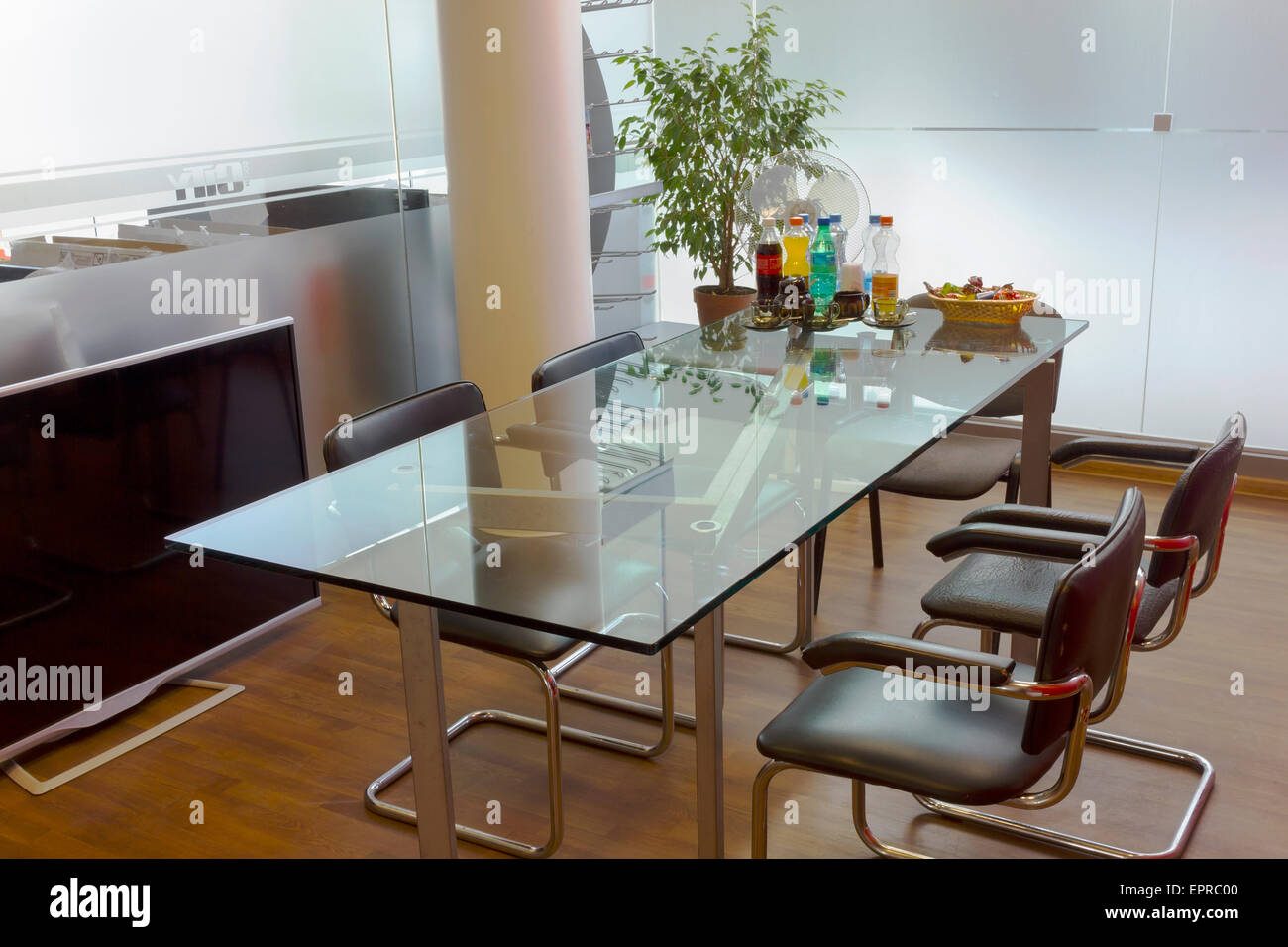 Meeting Lunch Break In A Small Conference Hall With Glass Walls And - Small glass conference table