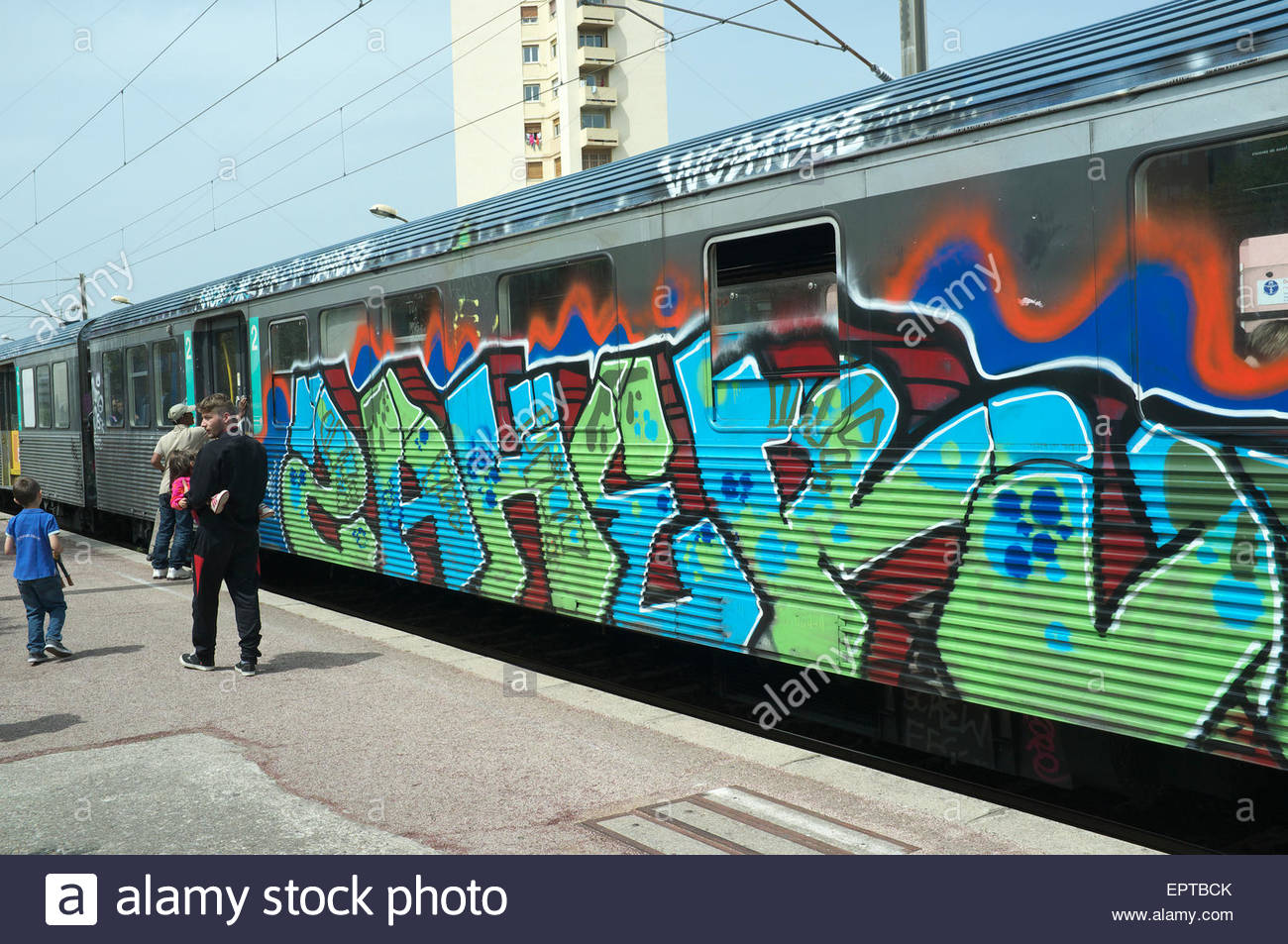 Graffiti covered passenger railway carriage, in public use, on the French TER railway network near Nice, France.Stock Photo