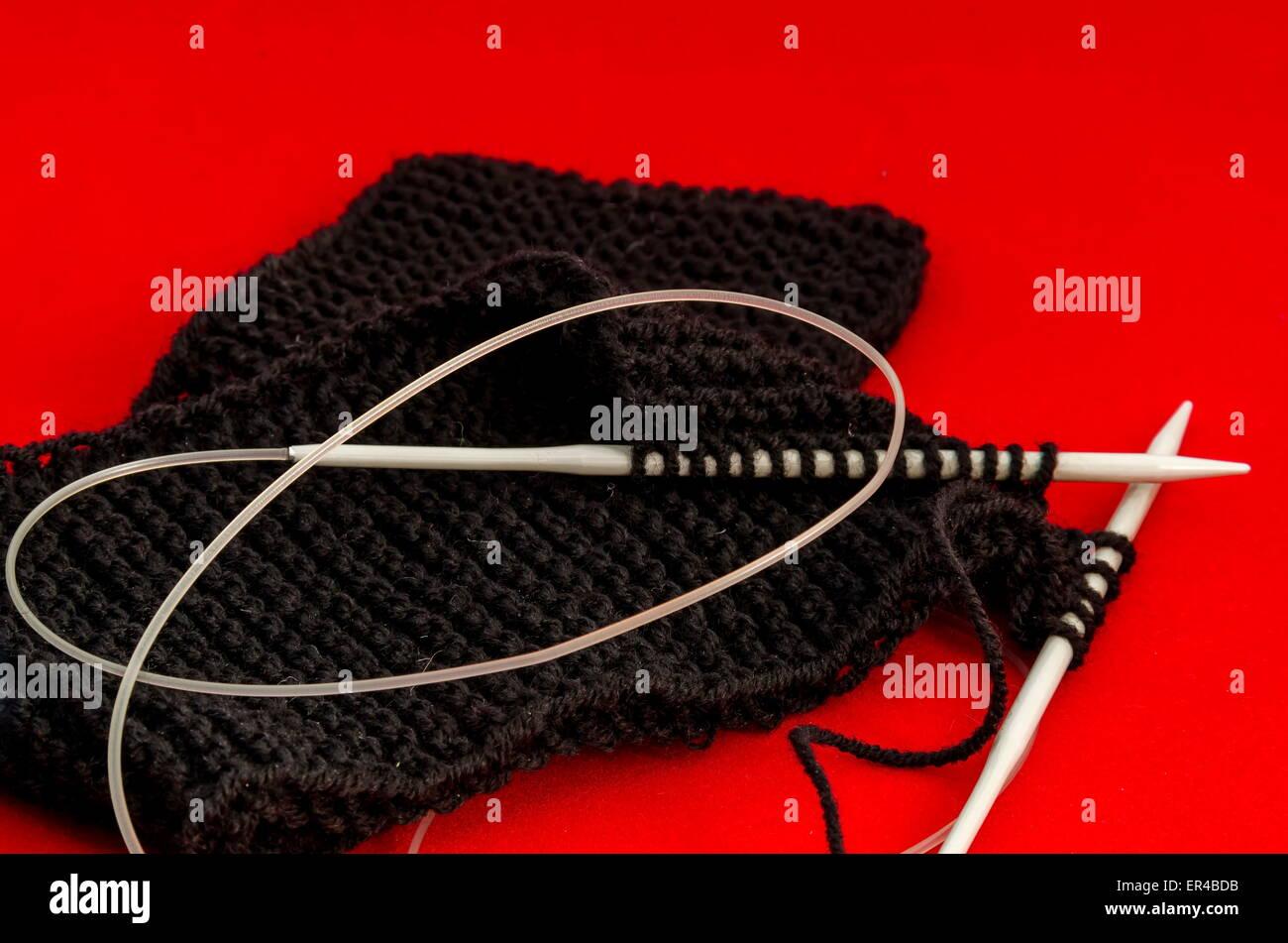 Stitch with knitting-needle of my wife - orange background - Stock Image