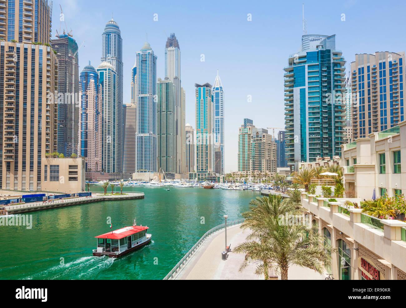 Dubai Marina Skyline and harbour with water taxi Dubai City United Arab Emirates UAE Middle east - Stock Image