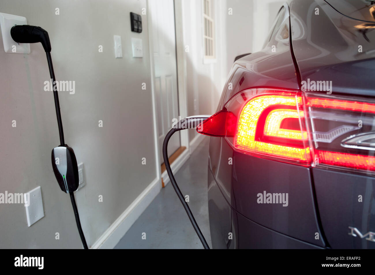 a-model-s-tesla-all-electric-car-automobile-being-charged-in-a-home-ERAFP2.jpg