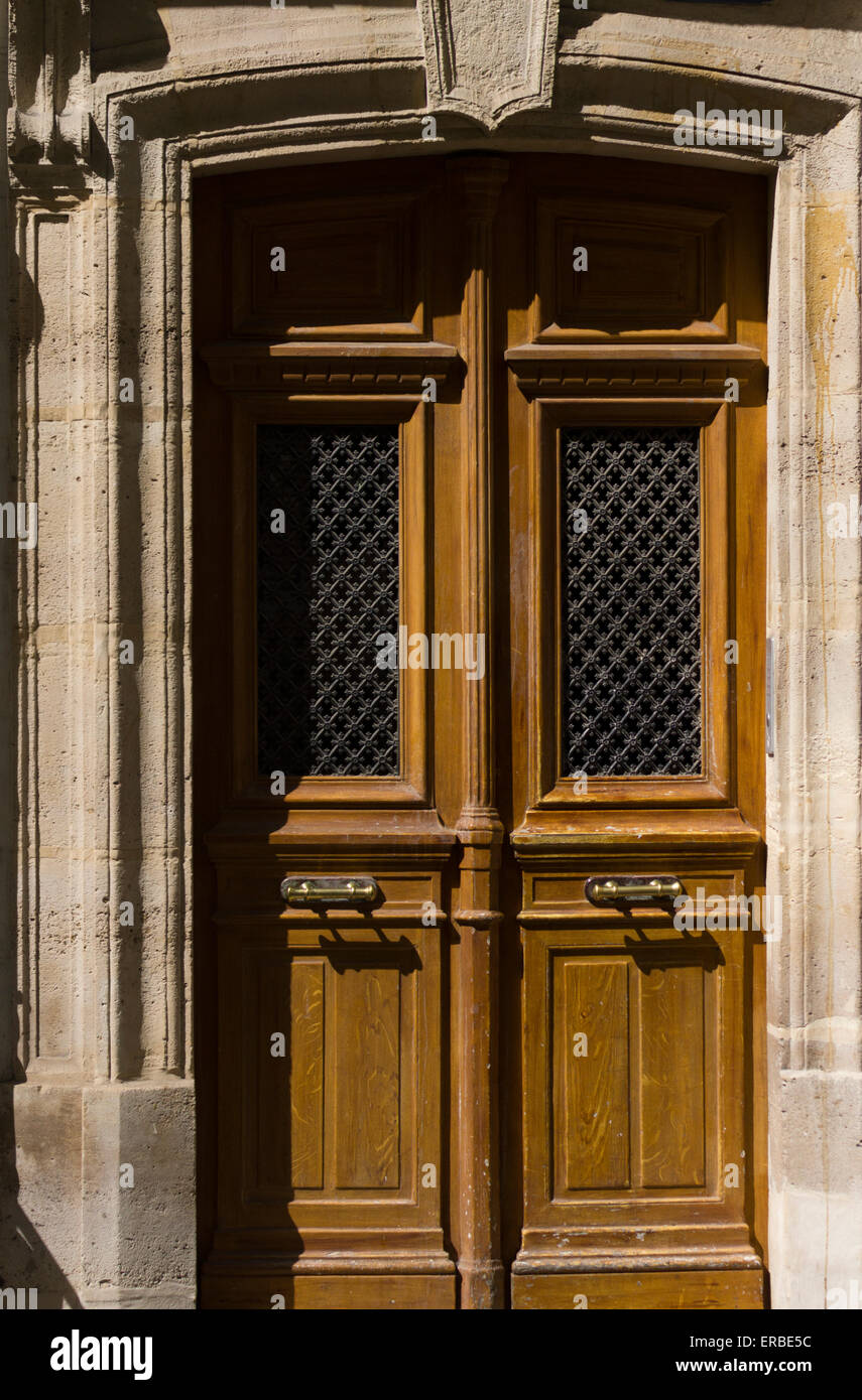 a-wooden-doorway-with-a-stone-surround-i