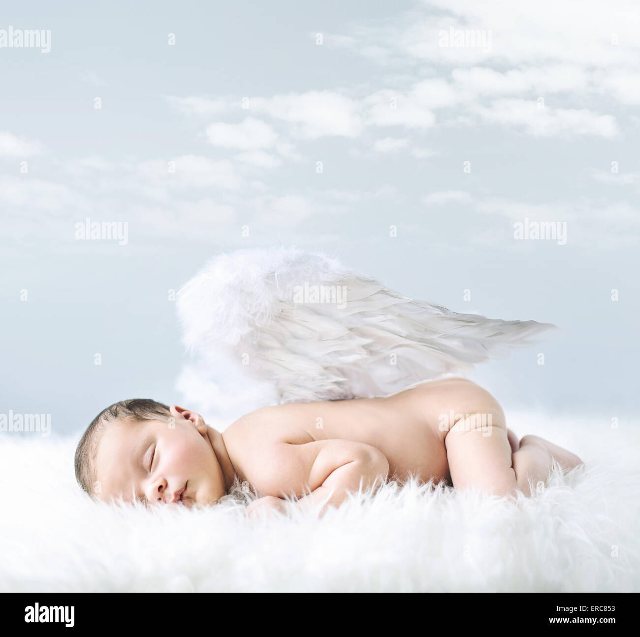 Portrait of a little baby as an innocent angel - Stock Image
