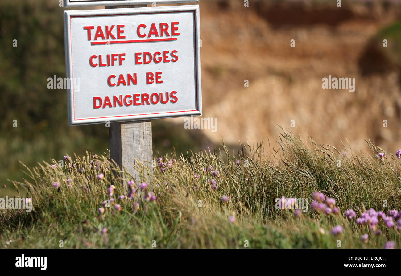 Sign at Freshwater Cliffs and Freshwater Bay warning cliff edges can be dangerous - Stock Image