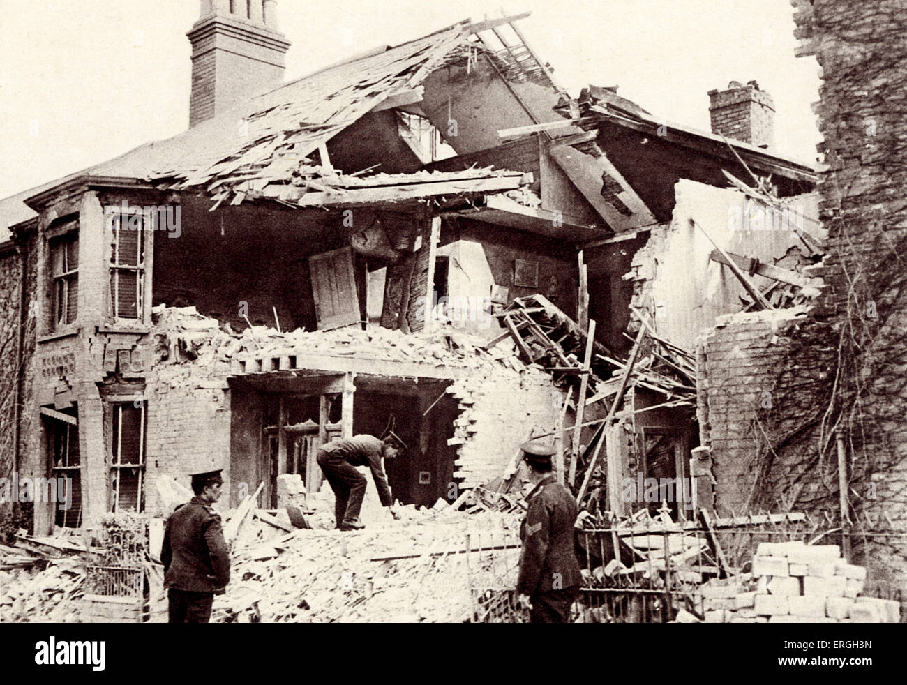 House destroyed by German bombing during World War 1. 1916. Lowestoft, Suffolk, UK. Two women and special constable - Stock Image