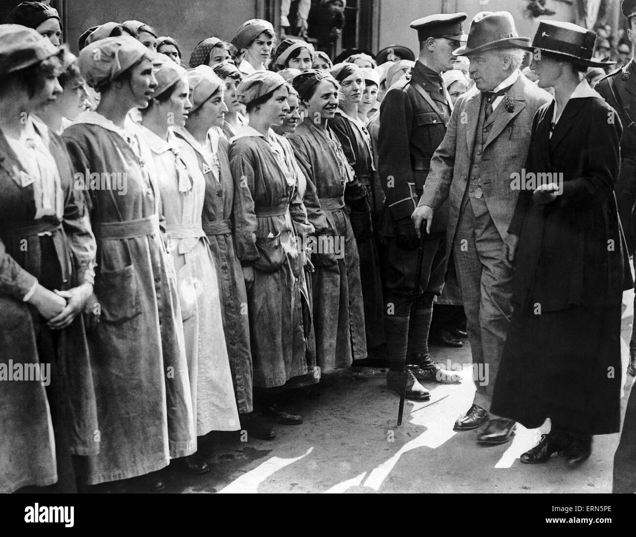 British Prime Minister David Lloyd George inspecting munitions workers during a visit to a fatory in Neath, Wales. - Stock Image