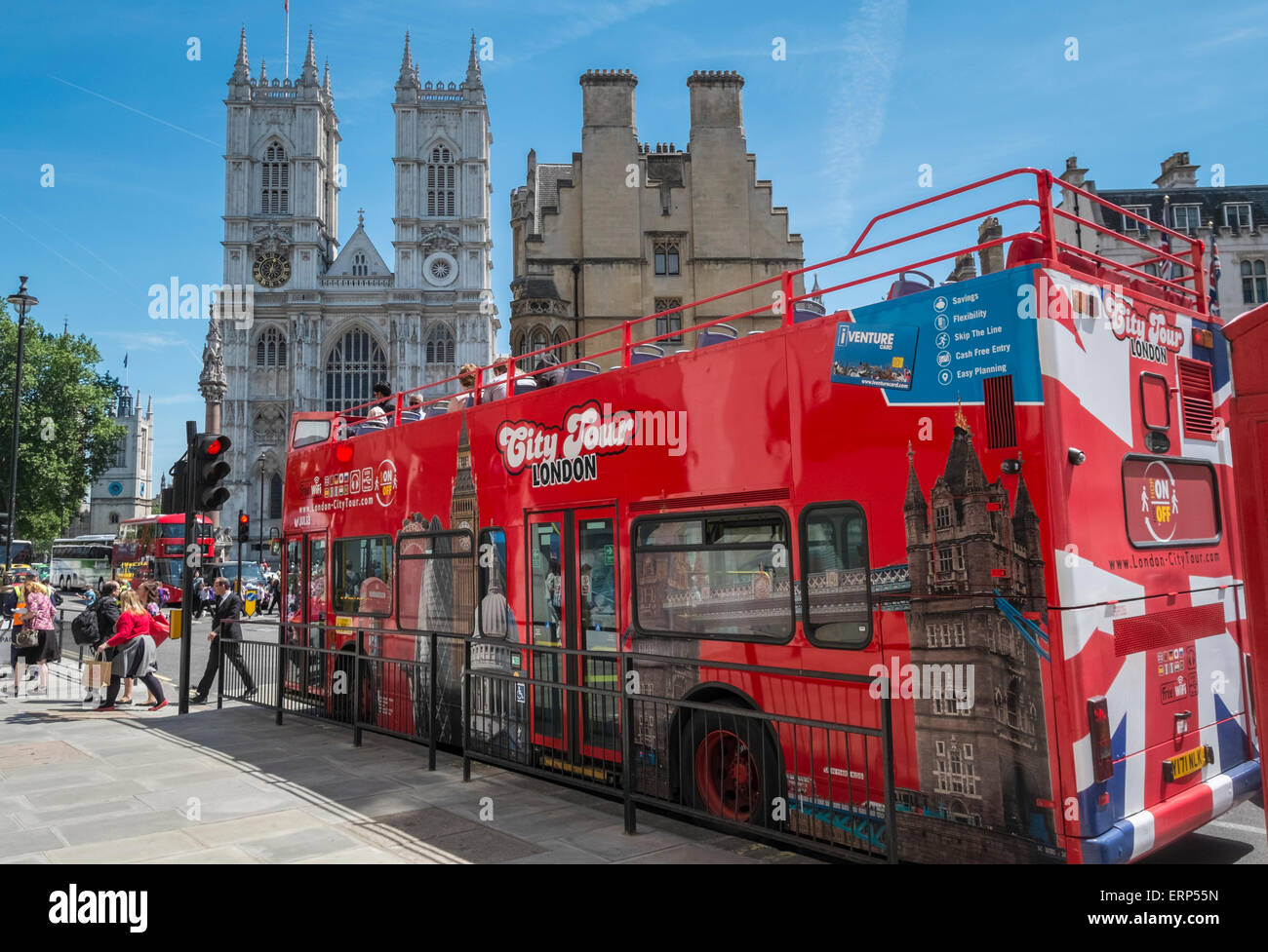 London City sightseeing open top tour bus with Westminster Abbey in the background, London, England UK - Stock Image