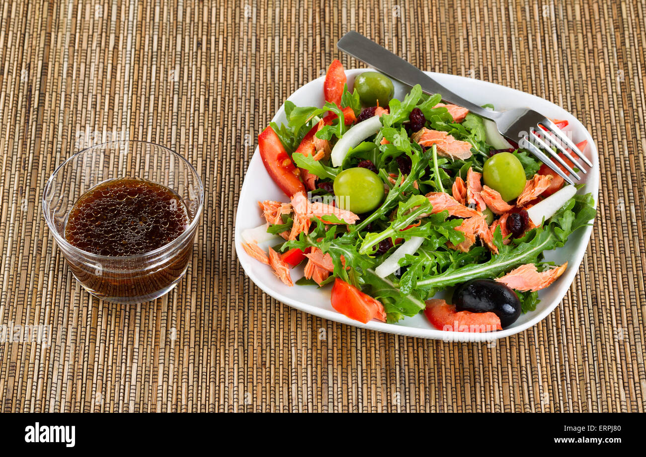 Close up of fresh green leaf salad, vegetables and smoked salmon on ...