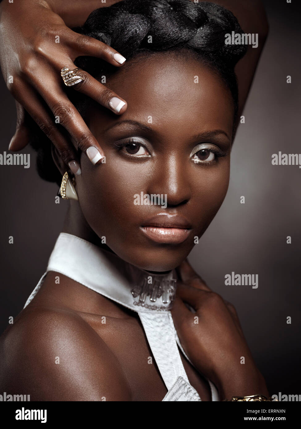 Beautiful young african-american woman artistic beauty portrait isolated on black background - Stock Image
