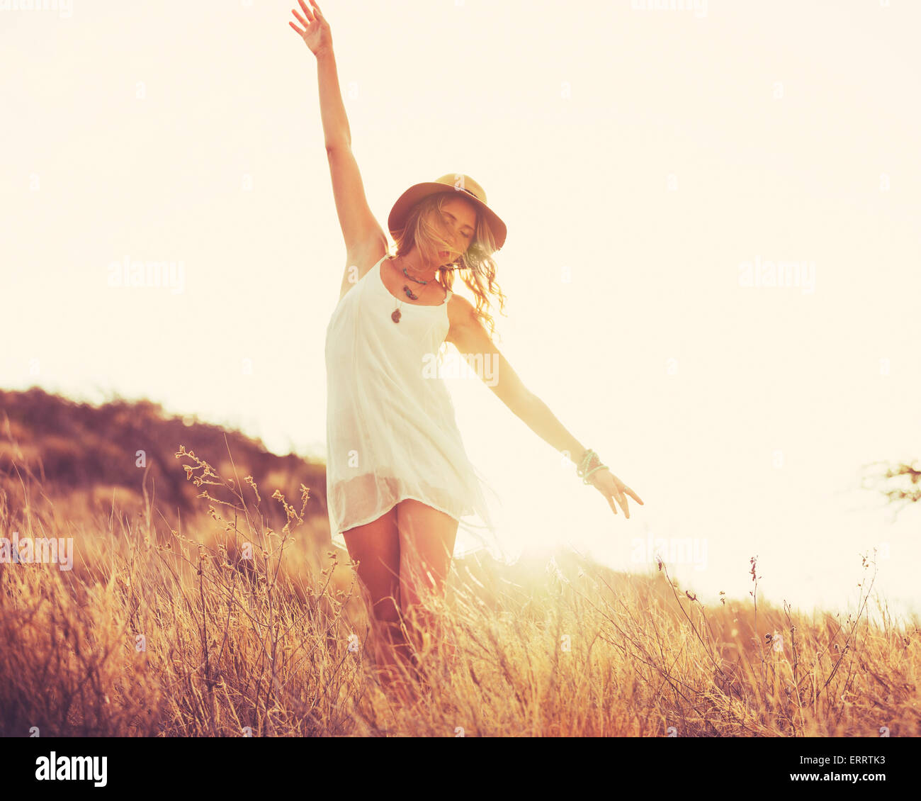 Fashion Portrait of Young Hipster Woman at Sunset, Retro Style Color Tones - Stock Image