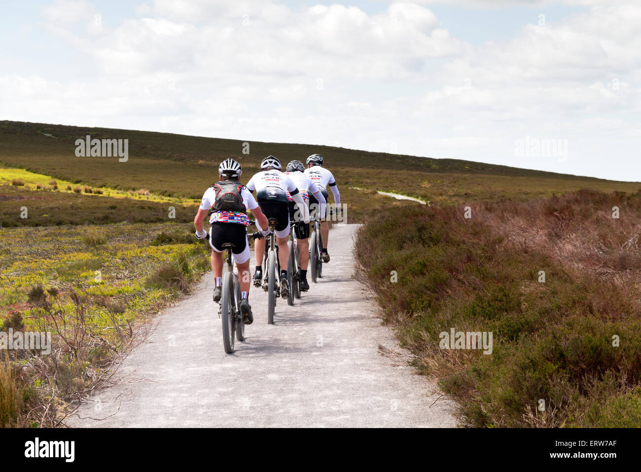 Four cyclists cycling along the Long Mynd in Shropshire Stock Photo