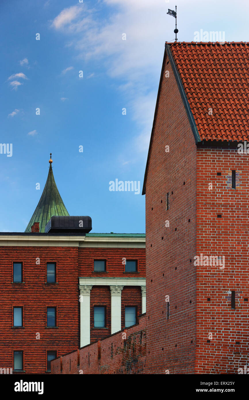 The tower of the fortress wall and the wall of the military museum of red brick in Riga - Stock Image